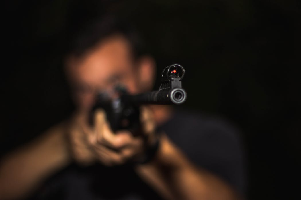 man pointing a gun